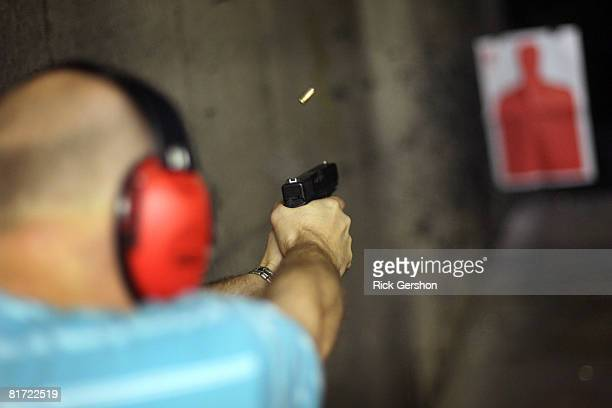John Sanders of Irving TX shoots his glock pistol June 26th at the DFW Gun Range and Training Center in Dallas Texas The US Supreme Court ruled...