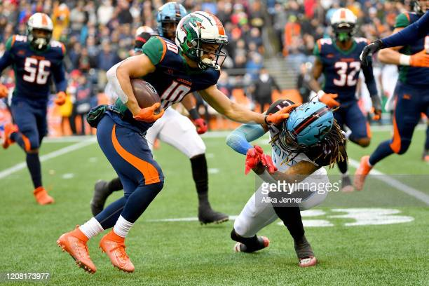 John Santiago of the Seattle Dragons gives Treston Decoud of the Dallas Renegades a stiff-arm during the fourth quarter of the game at CenturyLink...