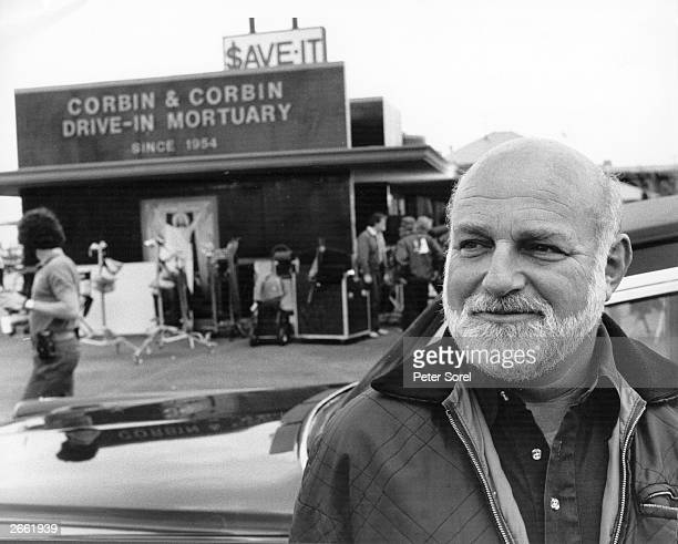 John Schlesinger the English actordirector outside a drivein mortuary in America