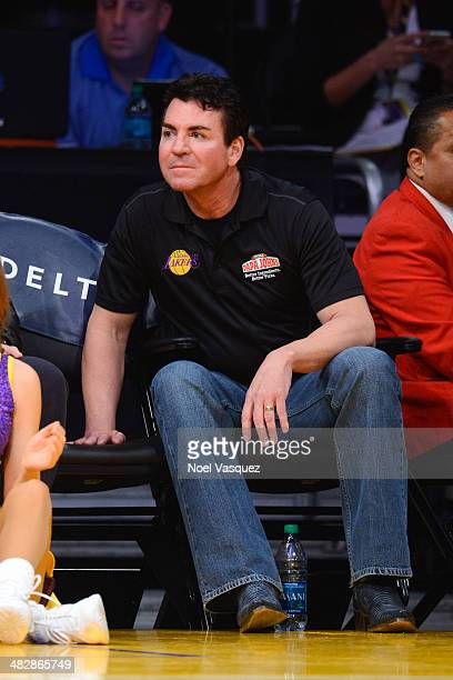 John Schnatter and Halston Sage attend a basketball game between the Dallas Mavericks and the Los Angeles Lakers at Staples Center on April 4 2014 in...