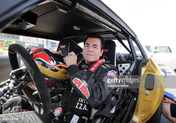 John Schnatter Founder and Chairman of the Board for Papa John's Pizza straps into his gold Chevy Camero Z28 to take on Antron Brown in a charity...