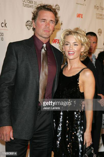 John Schneider and Kelly Carlson at the Season 5 Premiere of Nip/Tuck on October 20, 2007.