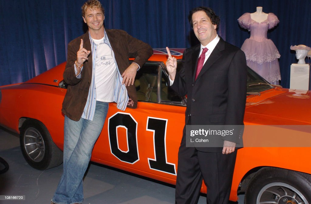 John Schneider and Peter Roth, president of Warner Bros. Television, with the original General Lee from The Dukes of Hazzard