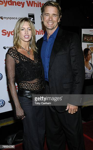 John Schneider and wife Elly Castle pose for a picture at the world premiere of 'Sydney White' at the Mann Bruin Theatre on September 20 2007 in...