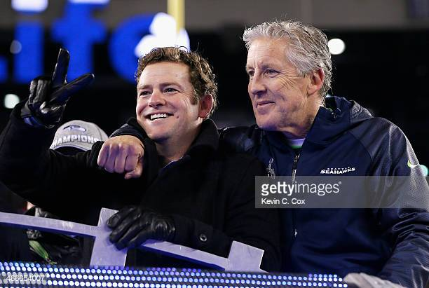 John Schneider General Manager of the Seattle Seahawks and head coach Pete Carroll celebrates after their 438 victory over the Denver Broncos during...