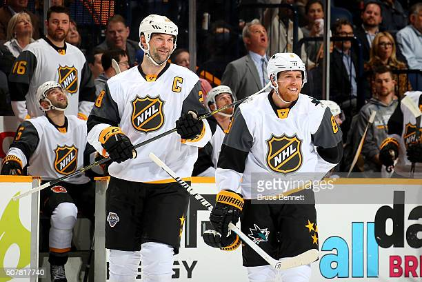 John Scott of the Arizona Coyotes and Joe Pavelski of the San Jose Sharks celebrate defeating the Central Division AllStars during the Western...