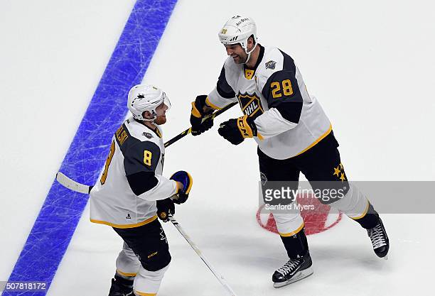 John Scott of the Arizona Coyotes and Joe Pavelski of the San Jose Sharks celebrate during the Western Conference Semifinal Game between the Central...