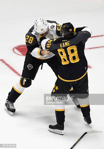 John Scott of the Arizona Coyotes and Patrick Kane of the Chicago Blackhawks joke around during the Western Conference Semifinal Game between the...