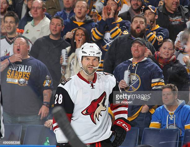 John Scott of the Arizona Coyotes looks on as Buffalo Sabres fans react to a skirmish during an NHL game on December 4 2015 at the First Niagara...