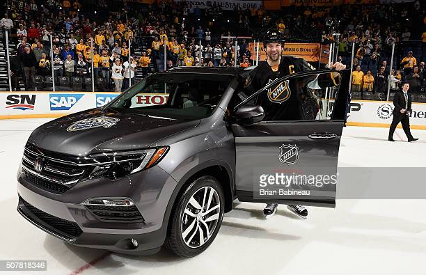 John Scott of the Arizona Coyotes of the Pacific Division AllStars poses with his 2016 Honda Pilot as a reward for being named 2016 Honda NHL AllStar...