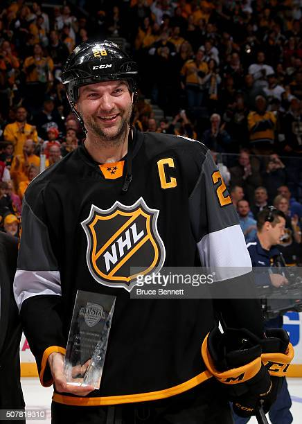 John Scott of the Arizona Coyotes poses with the MVP trophy after the 2016 Honda NHL AllStar Final Game between the Eastern Conference and the...
