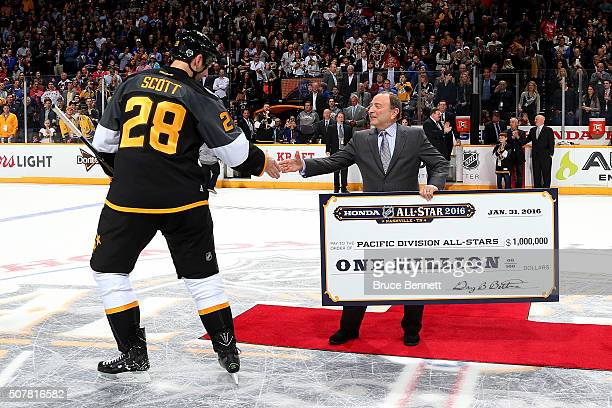 John Scott of the Arizona Coyotes shakes hands with NHL Commissioner Gary Bettman after the 2016 Honda NHL AllStar Final Game between the Eastern...