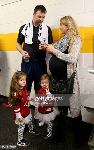 John Scott of the Arizona Coyotes talks with wife Danielle Scott after the 2016 Honda NHL AllStar Final Game between the Eastern Conference and the...