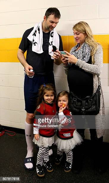 John Scott of the Arizona Coyotes talks with wife Danielle Scott after the 2016 Honda NHL All-Star Final Game between the Eastern Conference and the...