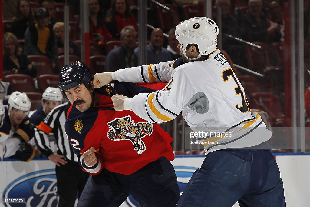 John Scott #32 of the Buffalo Sabres and George Parros #22 of the Florida Panthers fight during the first period at the BB&T Center on February 28, 2013 in Sunrise, Florida.