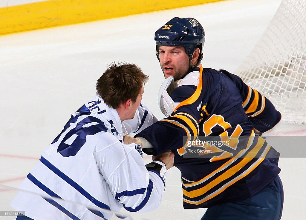 John Scott #32 of the Buffalo Sabres fights with Frazer McLaren #38 of the Toronto Maple Leafs in the first period at First Niagara Center on March 21, 2013 in Buffalo, United States.