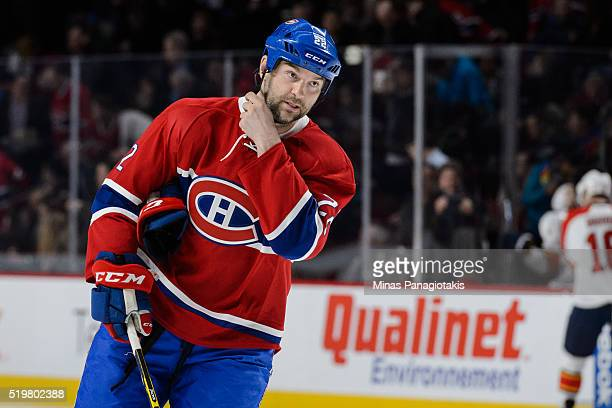 John Scott of the Montreal Canadiens adjusts his helmet during the NHL game against the Florida Panthers at the Bell Centre on April 5 2016 in...