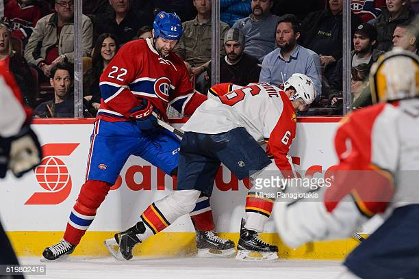 John Scott of the Montreal Canadiens battles against the boards with Alex Petrovic of the Florida Panthers during the NHL game at the Bell Centre on...