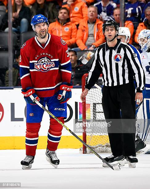 John Scott of the St John's IceCaps reacts to a penalty call during game action against the Toronto Marlies on March 26 2016 at Air Canada Centre in...