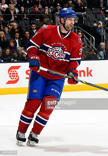 John Scott of the St John's IceCaps skates up ice against the Toronto Marlies during game action on March 26 2016 at Air Canada Centre in Toronto...