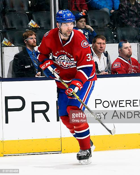 John Scott of the St. John's IceCaps turns up ice against the Toronto Marlies during game action on March 26, 2016 at Air Canada Centre in Toronto,...