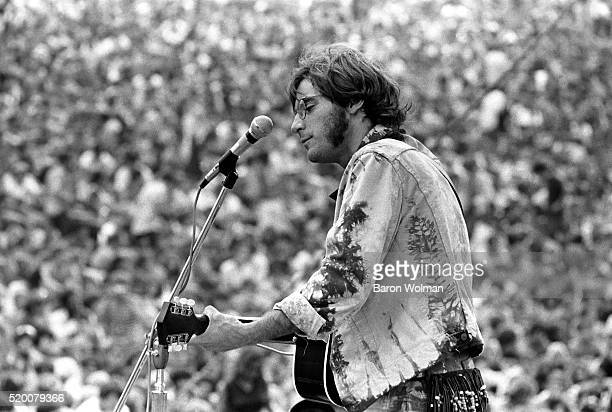 John Sebastian playing at the Woodstock Music Art Fair Bethel NY August 15 1969