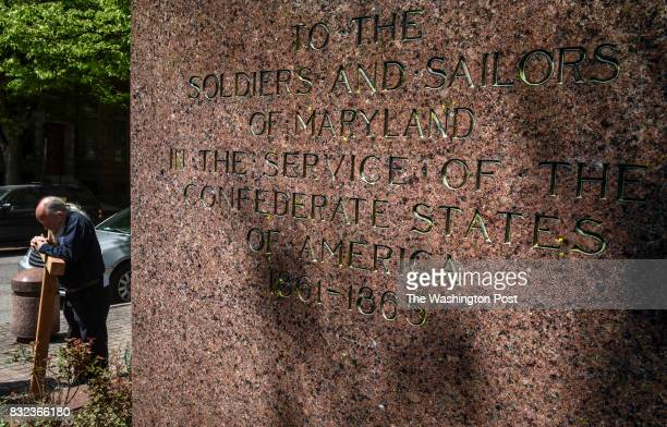 John Seeley prays in front of a memorial to Confederate sailors as clergy and members of Memorial Episcopal Church walk the Stations of the Cross...