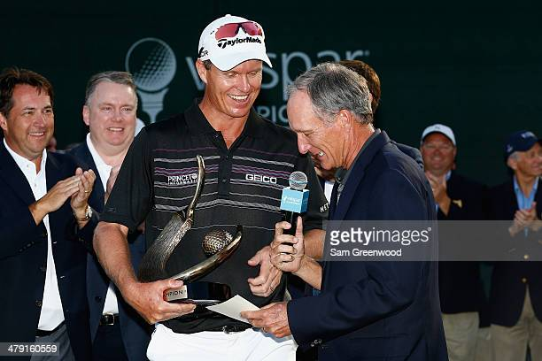 John Senden of Australia accepts his trophy after the final round of the Valspar Championship at Innisbrook Resort and Golf Club on March 16, 2014 in...