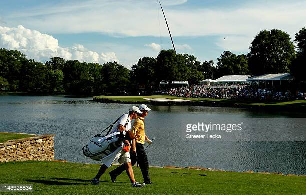 John Senden of Australia and caddie Josh Cassell walk to the 17th green during the third round of the Wells Fargo Championship at the Quail Hollow...