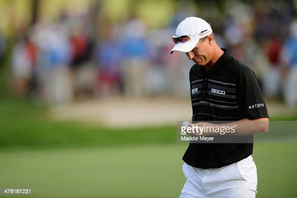 John Senden of Australia exits the 18th green following the final round of the Valspar Championship at Innisbrook Resort and Golf Club on March 16,...