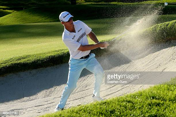 John Senden of Australia hits out of a bunker on the 9th hole in the second round of the Northern Trust Open at the Riviera Country Club on February...