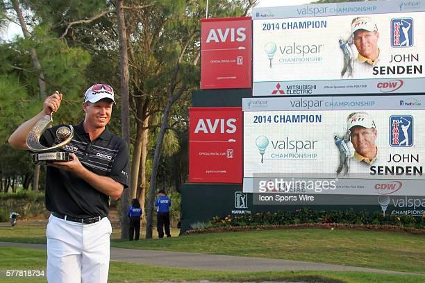John Senden of Brisbane, Queensland, Australia holds the winner's trophy after the final round of the Valspar Championship at Innisbrook Resort -...