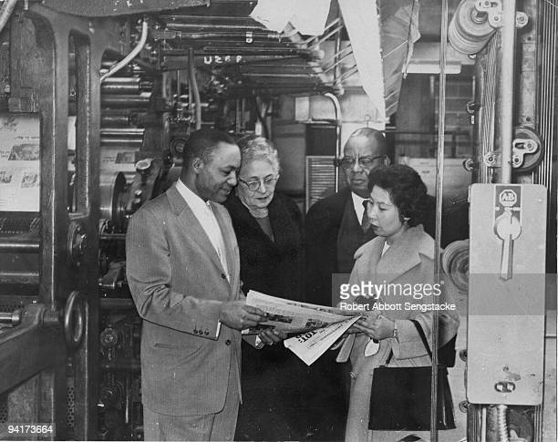 John Sengstacke Chicago Daily Defender publisher and board chairman of Sengstacke Newspapers and Illinois congressman William L Dawson and two...