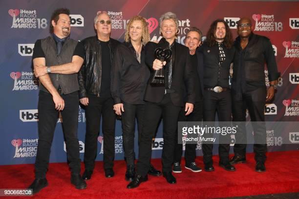 John Shanks Hugh McDonald David Bryan Jon Bon Jovi Tico Torres Phil X and Everett Bradley of Bon Jovi recipients of the Icon Award pose in the press...