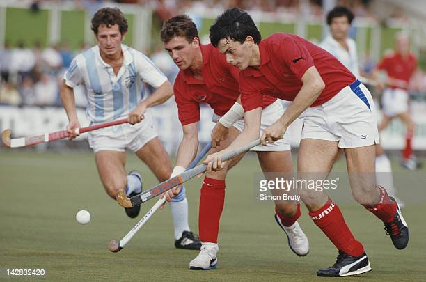John Shaw and Martyn Grimley of England in action against Argentina during their Pool A match at the 6th FIH Men's Field Hockey World Cup on 6th...