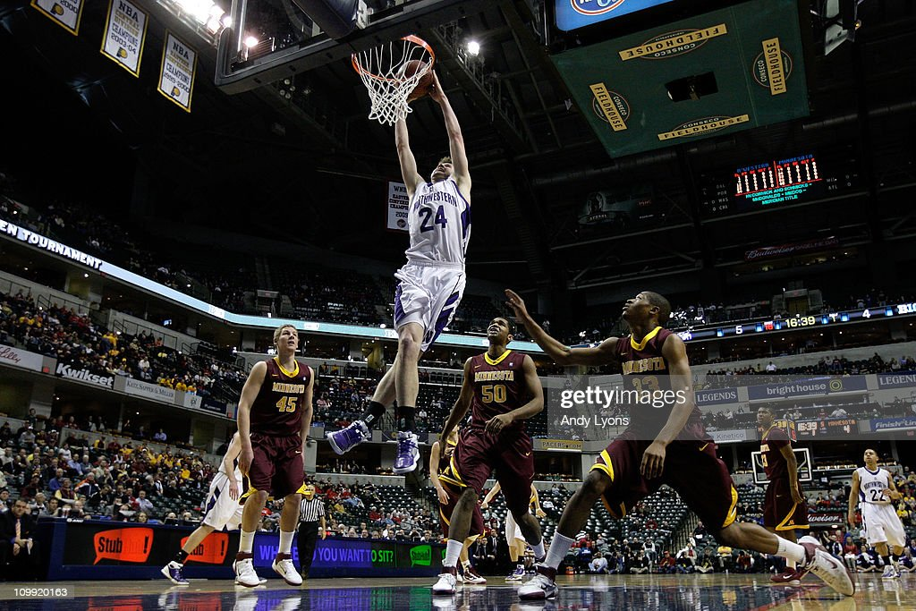 John Shurna #24 of the Northwestern Wildcats dunks against the Minnesota Golden Gophers during the first round of the 2011 Big Ten Men's Basketball Tournament at Conseco Fieldhouse on March 10, 2011 in Indianapolis, Indiana.
