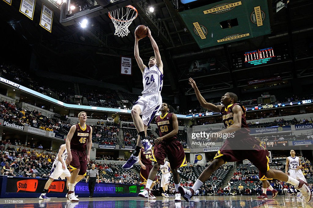 John Shurna #24 of the Northwestern Wildcats dunks against the Minnesota Golden Gophers during the first round of the 2011 Big Ten Men's Basketball Tournament at Conseco Fieldhouse on March 10, 2011 in Indianapolis, Indiana. Northwestern won 75-65.