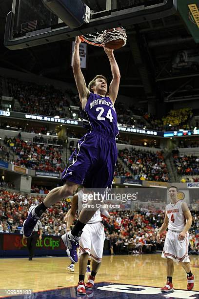 John Shurna of the Northwestern Wildcats dunks against the Ohio State Buckeyes during the quarterfinals of the 2011 Big Ten Men's Basketball...