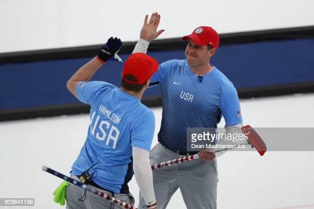 John Shuster and Matt Hamilton of the United States look on during the game against Sweden during the Curling Men's Gold Medal game on day fifteen of...