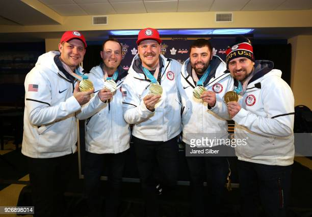 John Shuster Tyler George Matt Hamilton John Landsteiner and Joe Polo of the gold medalwinning 2018 US Olympic Curling Team hold up their gold medals...