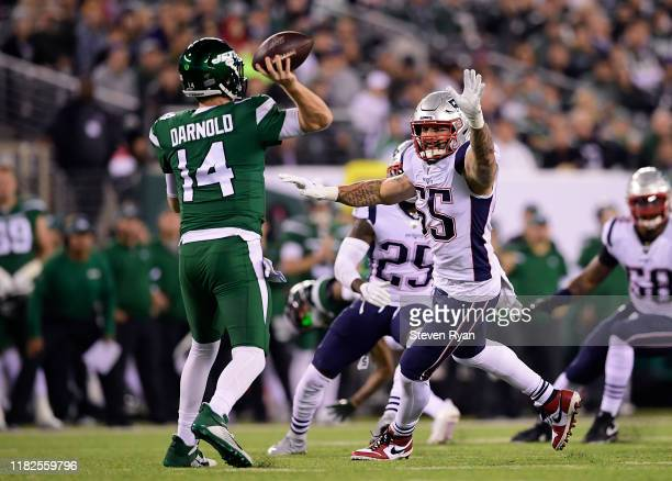John Simon of the New England Patriots attempts to block the pass from Sam Darnold of the New York Jets during the first half at MetLife Stadium on...