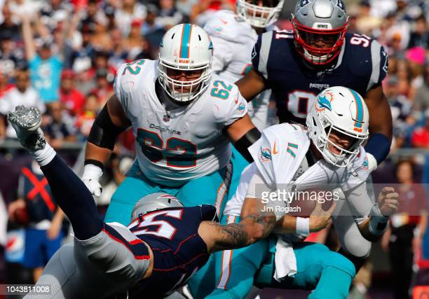 John Simon of the New England Patriots sacks Ryan Tannehill of the Miami Dolphins during the second half at Gillette Stadium on September 30 2018 in...