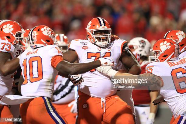 John Simpson of the Clemson Tigers reacts after running for a touchdown against the North Carolina State Wolfpack during their game at Carter-Finley...