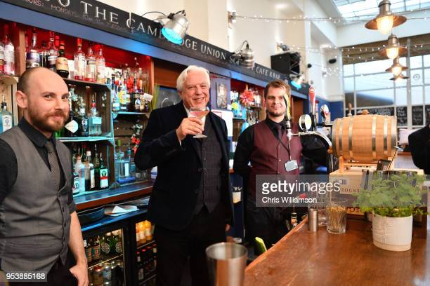 John Simpson tries a cocktail at the Cambridge Union on May 2 2018 in Cambridge England