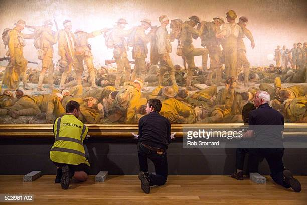 John Singer Sargent's First World War painting 'Gassed' is prepared for transport by staff at the IWM on April 25 2016 in London England The painting...