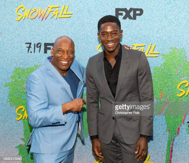 John Singleton and Damson Idris arrive to the premiere Of FX's 'Snowfall' Season 2 at Regal Cinemas LA LIVE Stadium 14 on July 16 2018 in Los Angeles...