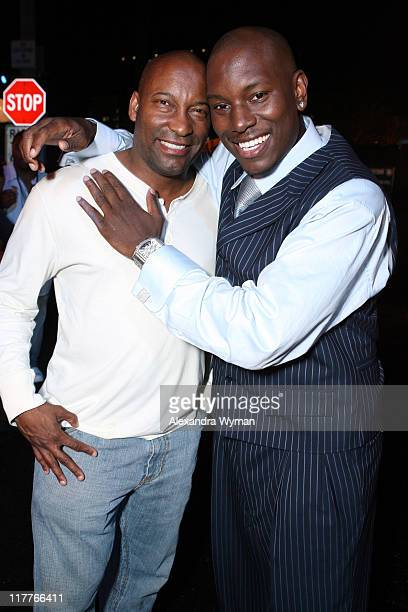 John Singleton and Tyrese Gibson during DreamWorks Pictures and Paramount Pictures Los Angeles Premiere of Transformers at Mann's Village Theater in...