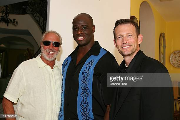 John Singleton Jr and Gregory Joiner attend the Trigg Ison Fine art exhibit for the work of Maxine Kim StussyFrankel at her home June 28 2008 in Los...
