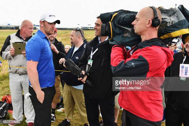 John Singleton of England speaks to the media during a practice round prior to the start of the 143rd Open Championship at Royal Liverpool on July 16...