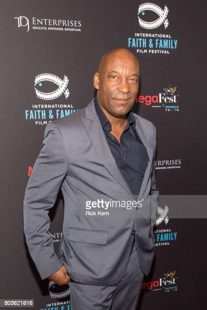 John Singleton poses before the MegaFest Leading Men In Hollywood Panel at the Omni Hotel on June 29 2017 in Dallas Texas